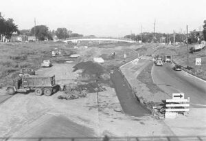 HIstorical photo of highway 94 under construction and tearing up the Rondo neighborhood, circa 1960s