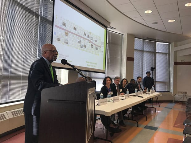 Marvin Anderson, chairman of ReConnectRondo, at left, introduces ULI's Advisory Services panel as they present their findings in St. Paul
