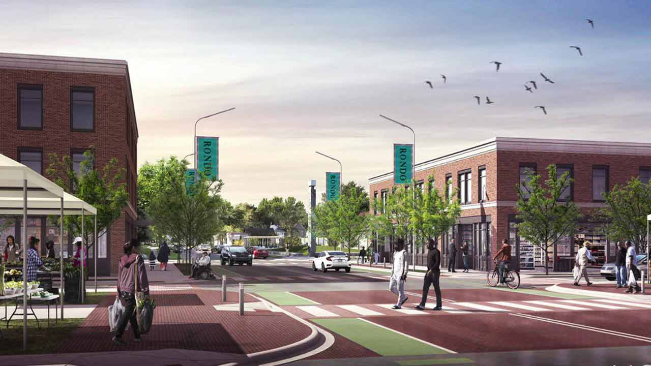 A rendering of a possible development for an African American development district in Rondo, showing wide open streets, trees, and businesses.