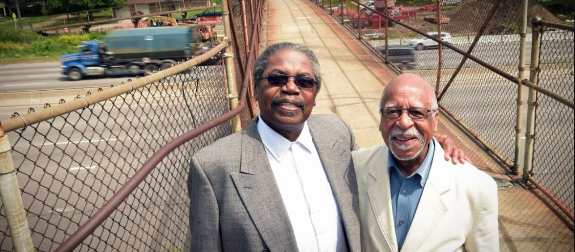 Floyd Smaller, left, and Marvin Anderson stand on a footbridge over Interstate 94, and are leaders in the movement to get community involvement in the design of the I-94 bridges in the Rondo neighborhood in St. Paul, Wednesday, June 8, 2016. (Pioneer Press: Scott Takushi)